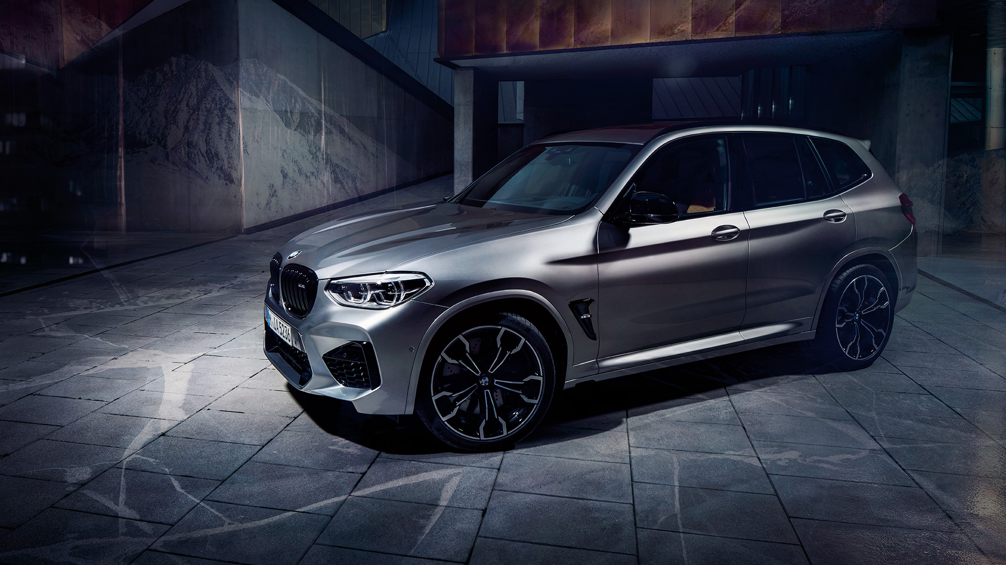 BMW X3 M Competition in Donington Grey metallic, exterior, side view.
